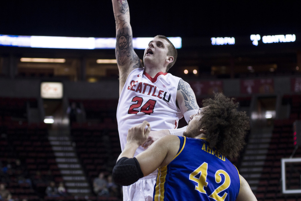 #24 Jack Crook shoots over the CSU Bakersfield center