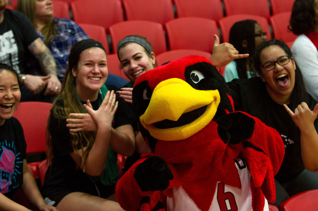 Rudy the Redhawk poses with a few students in the crowd