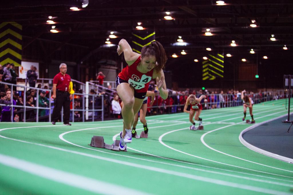 Alisa Poplawski leaves the blocks in the women's 400m.