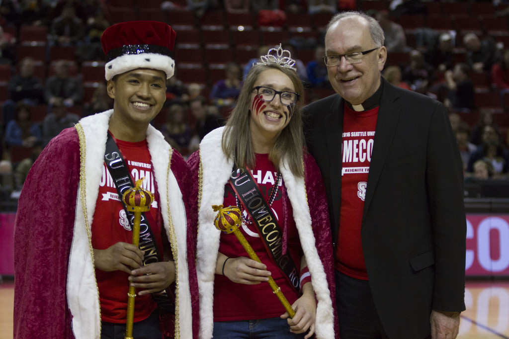 Homecoming King Danicole Ramos and Homecoming Queen Jen Cruz pose with Father Sunborg after being crowned