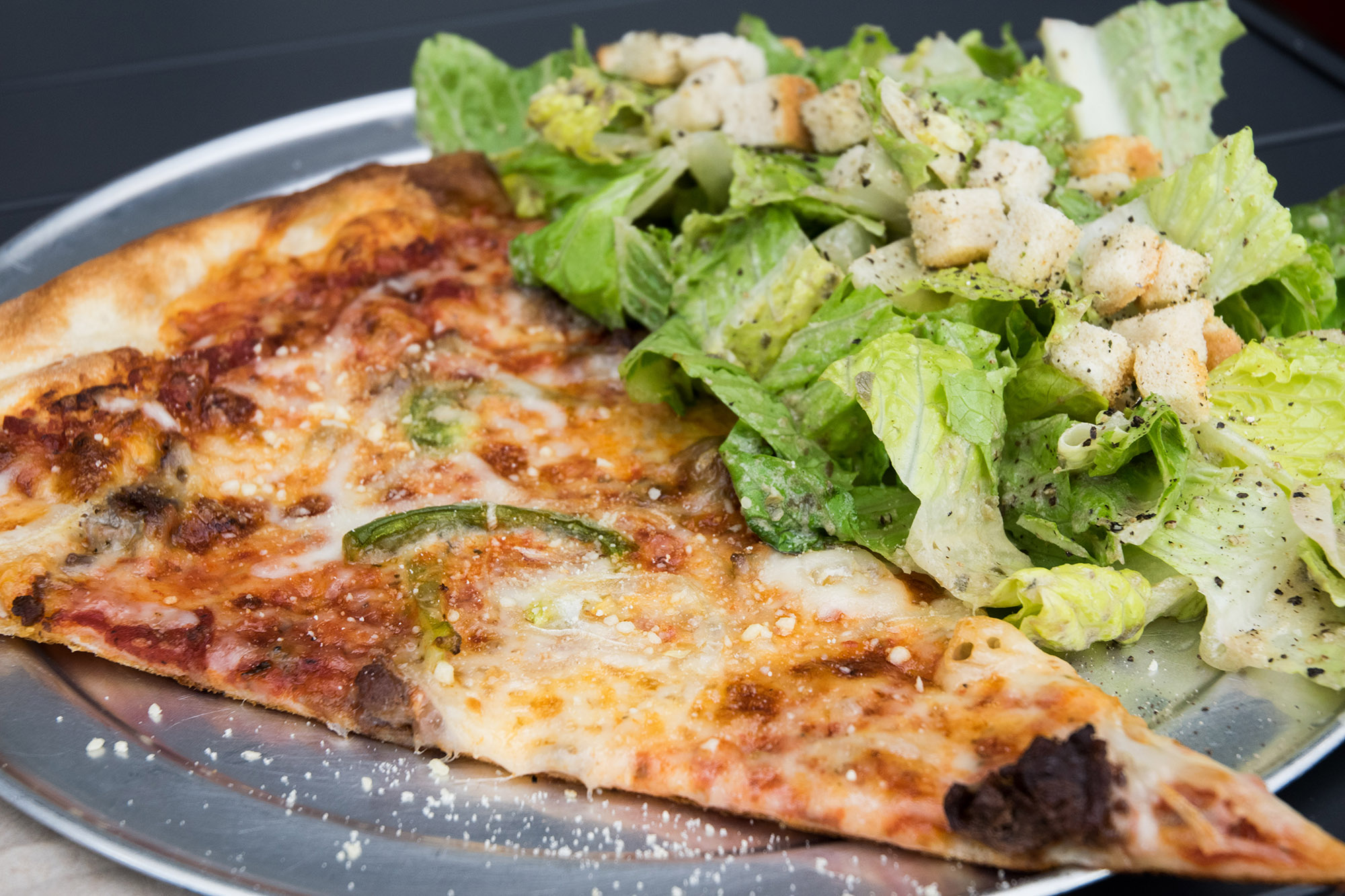 Sizzle Pie is the a new pizza spot in Capitol Hill that offers artisan pizzas and microbrewed beer.