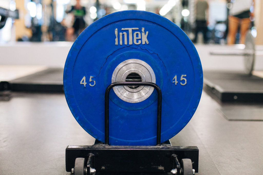 A cracked 45 pound weight rests at the end of the rack. |Cam Peters