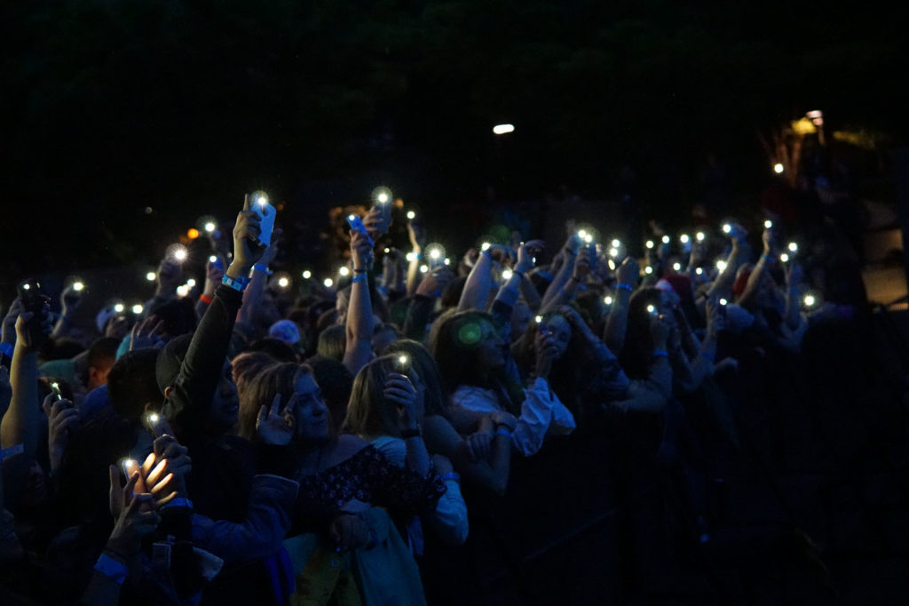 Like a field of fireflies, audience members used their phones to soften the mood