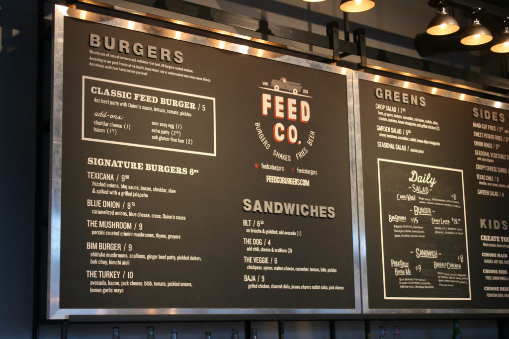A large menu displays the burger options at Feed Co. |Samira Shobeiri