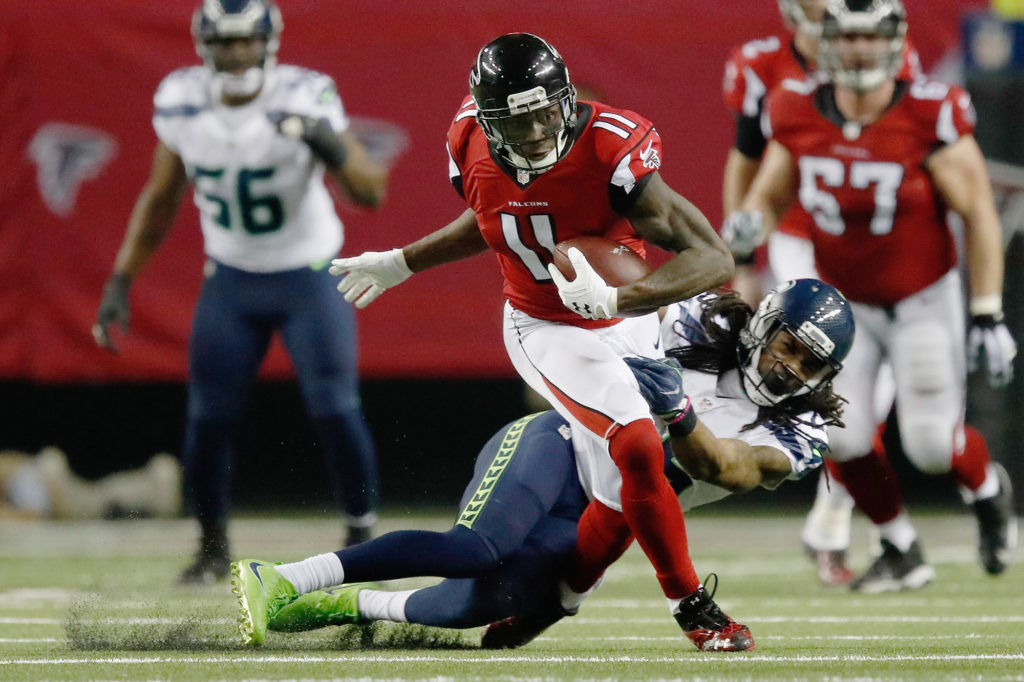 (No.11) Julio Jones breaks away from Richard Sherman for a touchdown. | Gregory Shamus, Getty Images