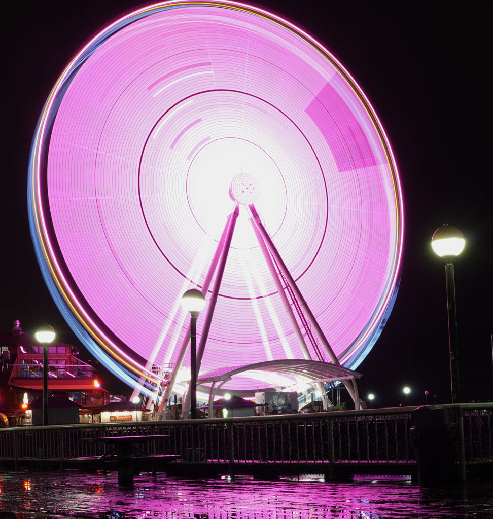 The Great Wheel near the waterfront shined Red Hawk red for Seattle University Weekend. |Nick Turner
