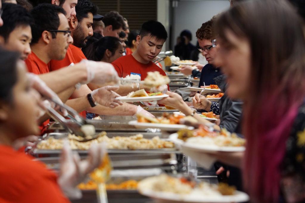 Student+volunteers+serve+eager+attendees.