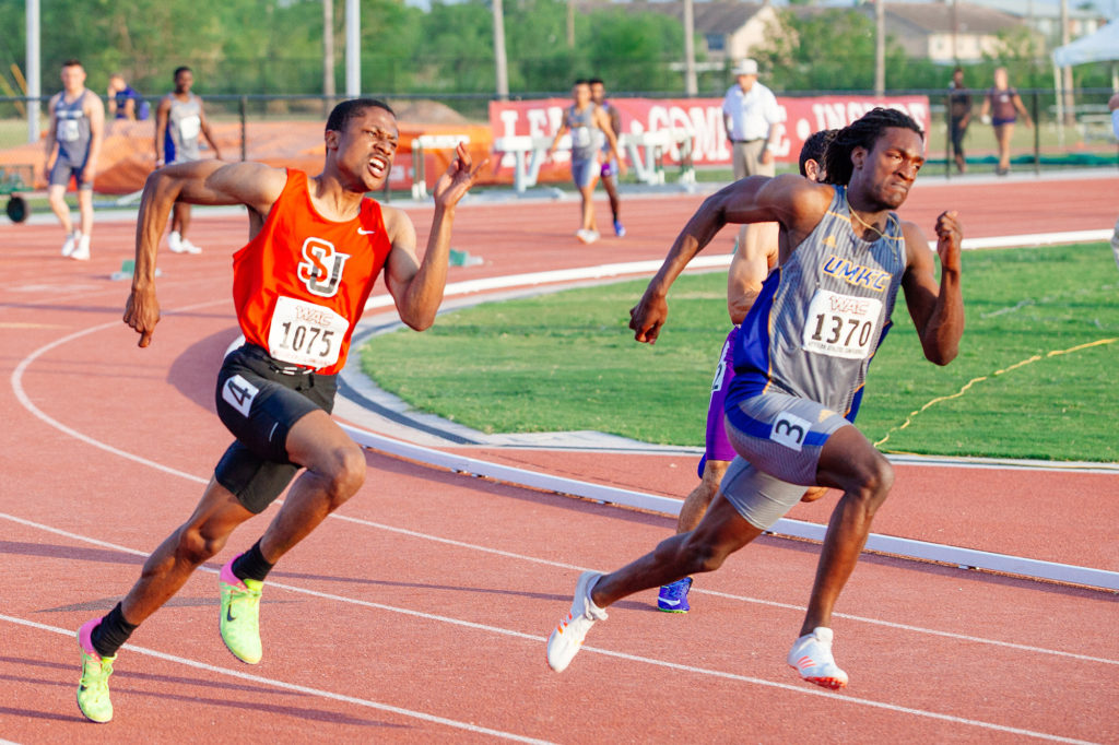 Keith Beasley battles an opponent from UMKC in the men's 200m dash.