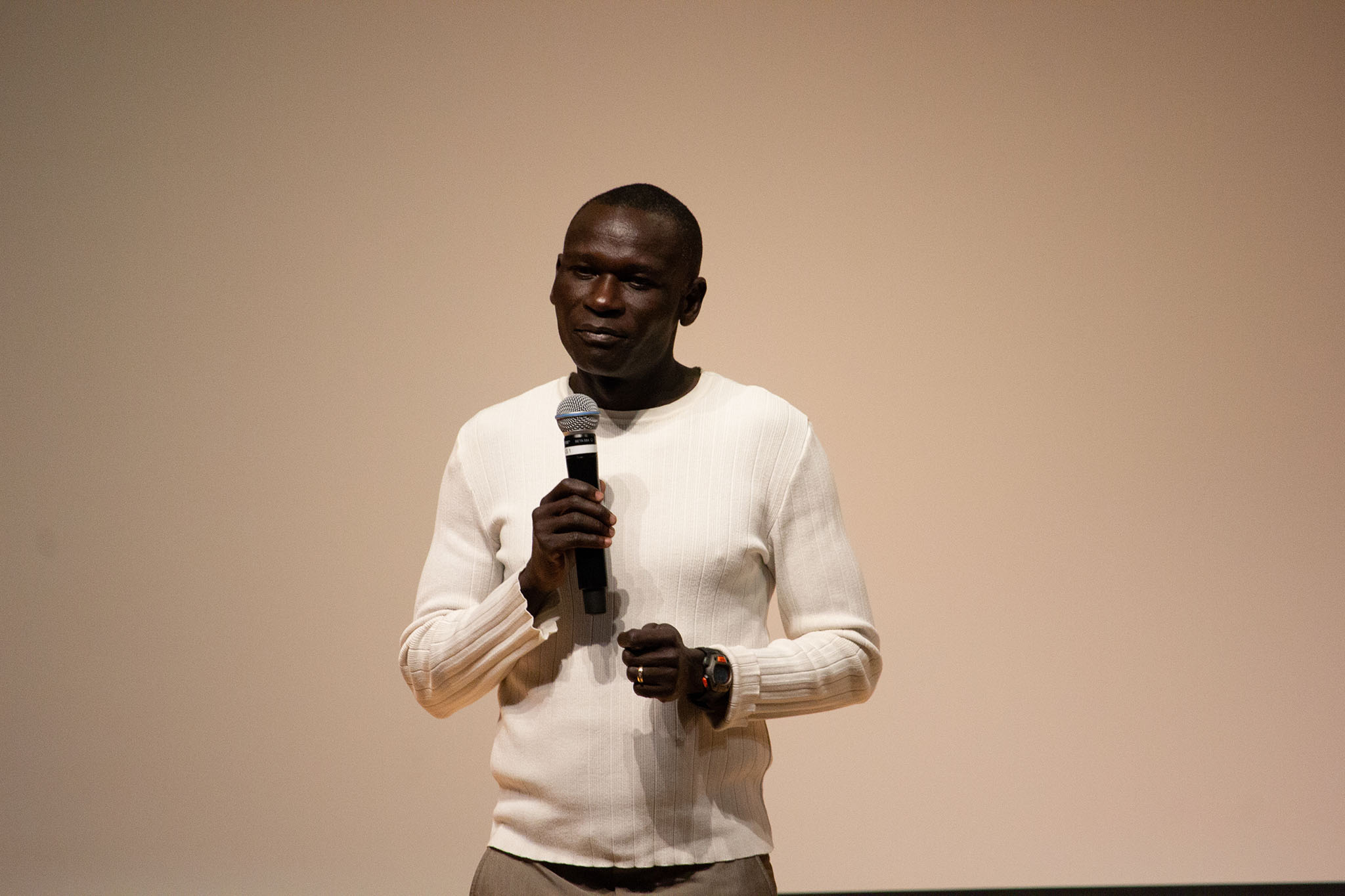 Julius Achon shares his story with student athletes in Pigott Auditorium.