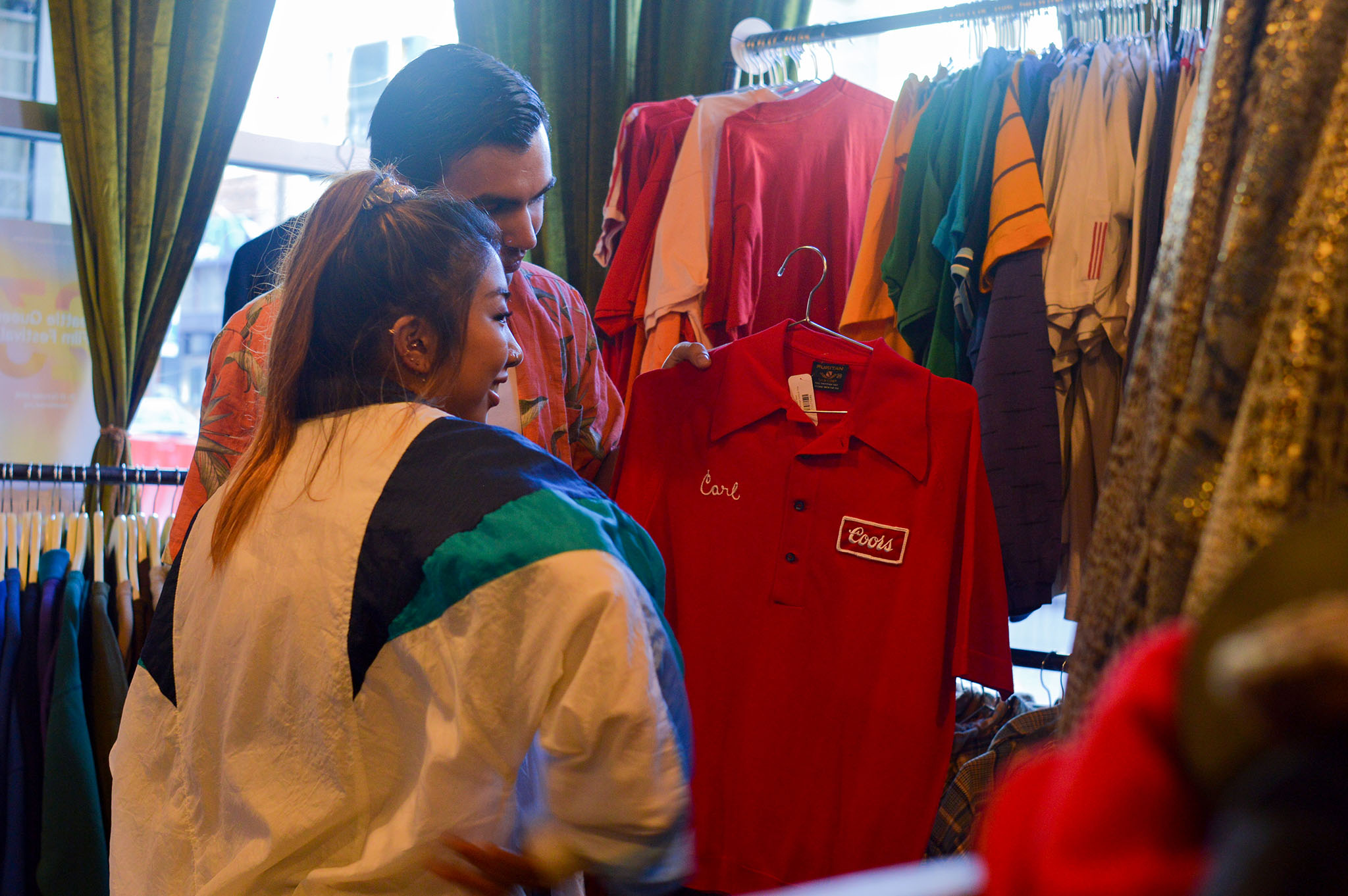 Renee Soliman and Andrew Manley search through racks of funky, affordable pieces in one of Capitol Hill's many local thrift stores.