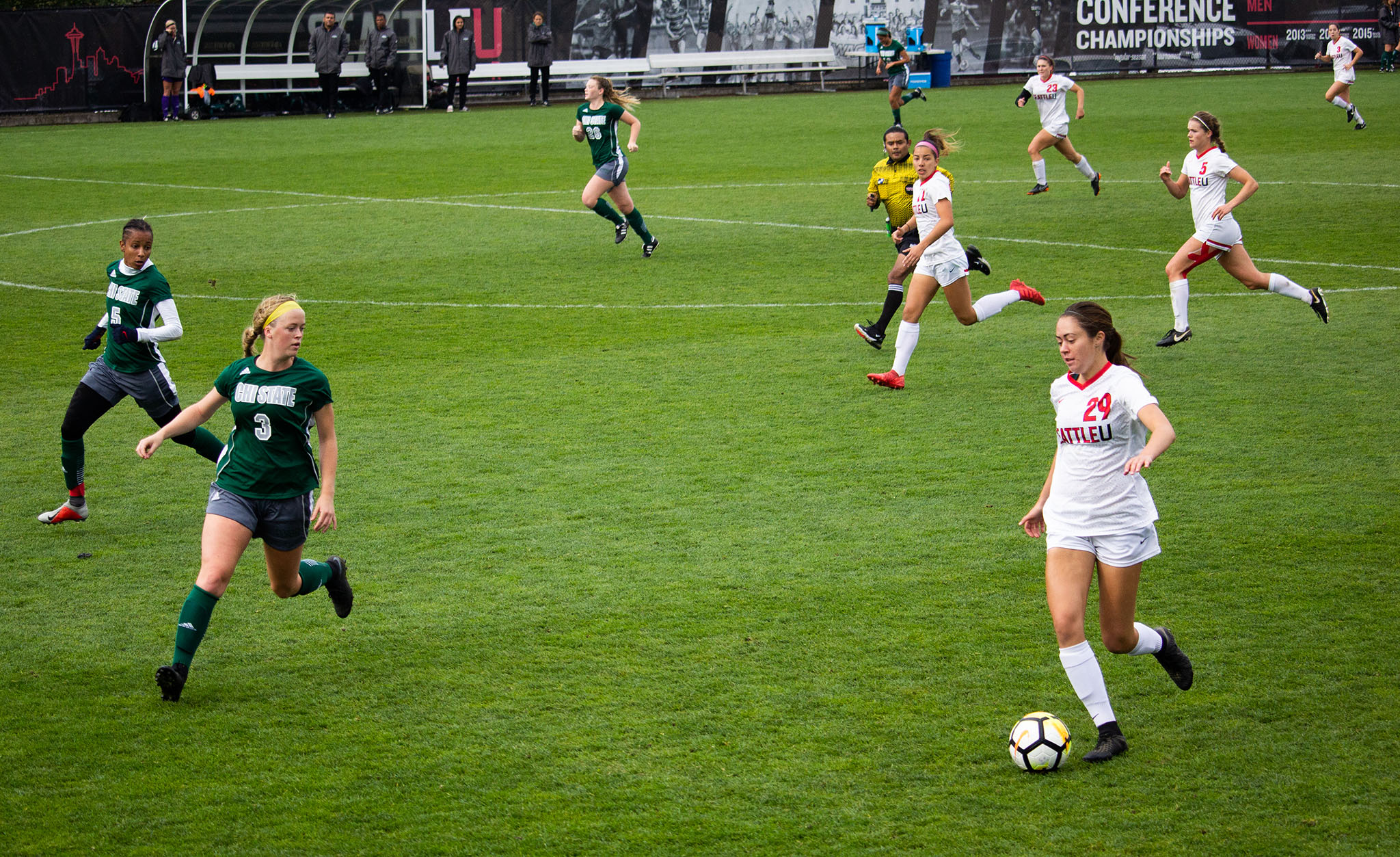 Julia Humphreys (29) dribbles the ball down the flank of the field.