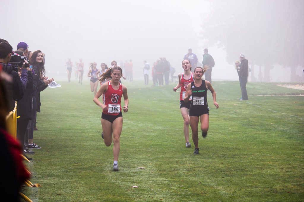Megan Delorey and Rachel Kastama finishing in the Women's Cross Country WAC Championships.