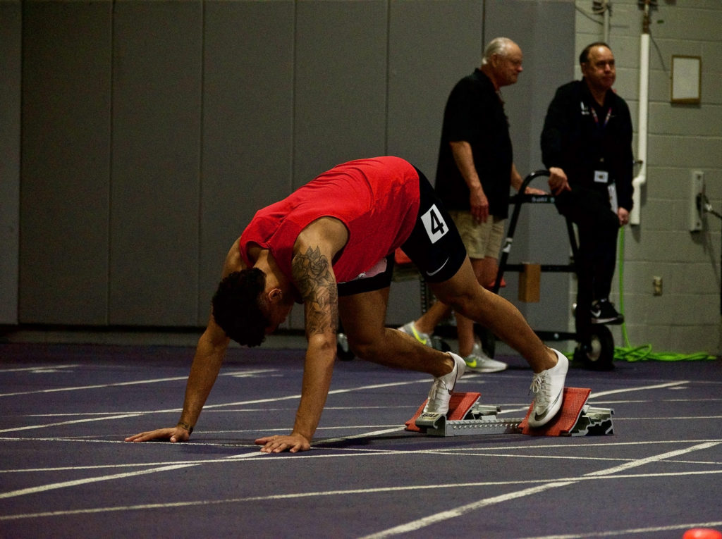 Kailan Claiborne settles into his starting blocks before his race.