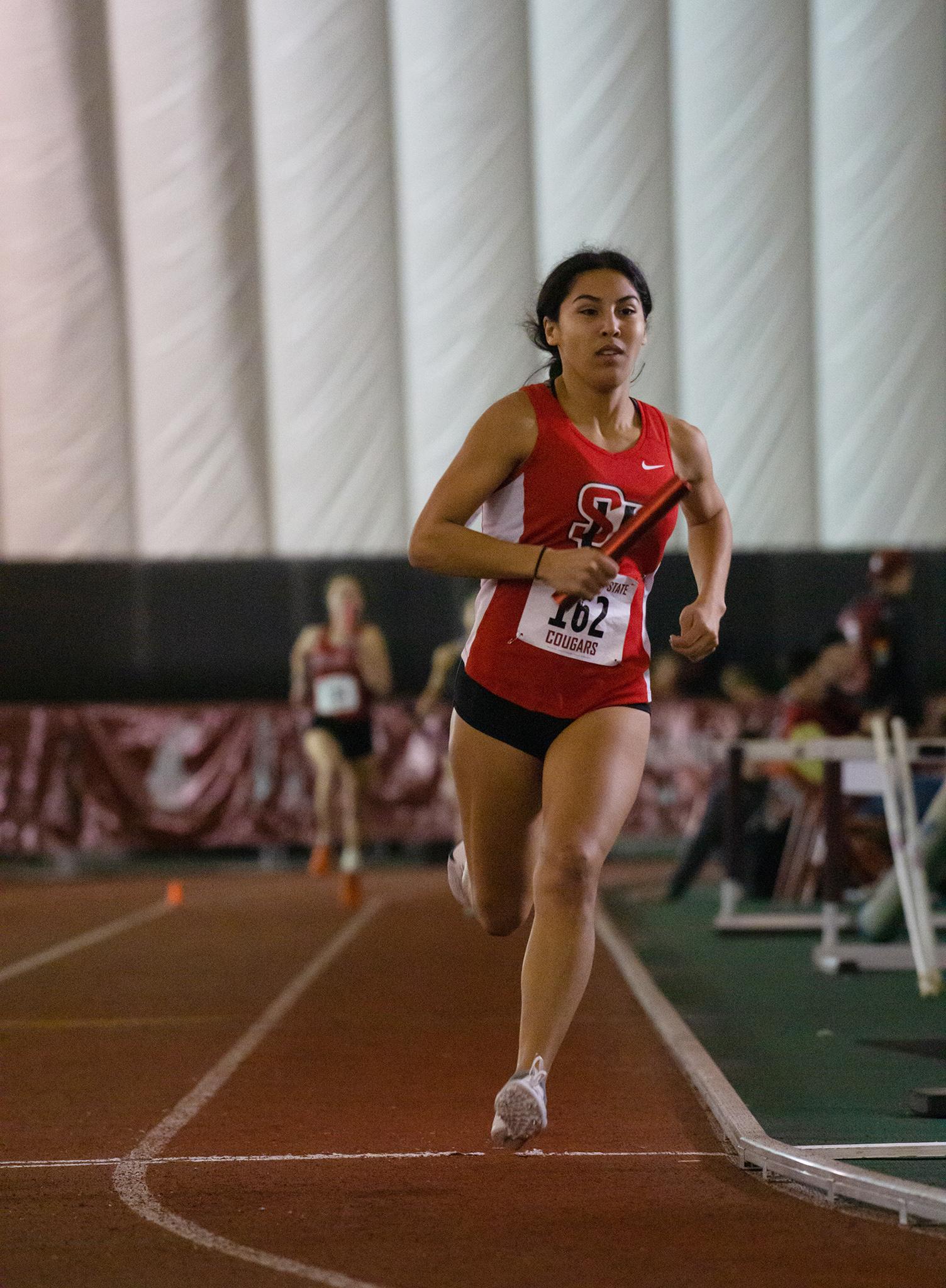 Siobhan Rubio running in the 4x400m in UW's indoor track meet last week.