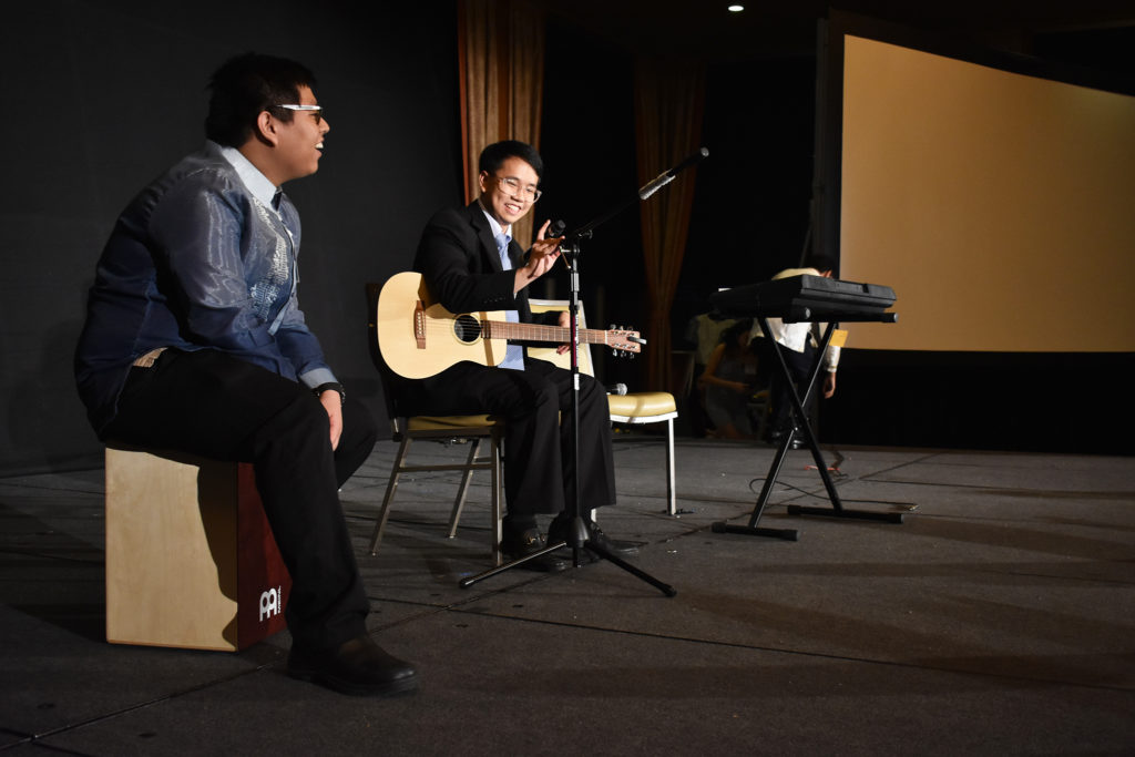 From left to right, Justin Paeste and Huy Pham perform various pop songs during the dinner reception at the United Filipino's Club annual Barrio.