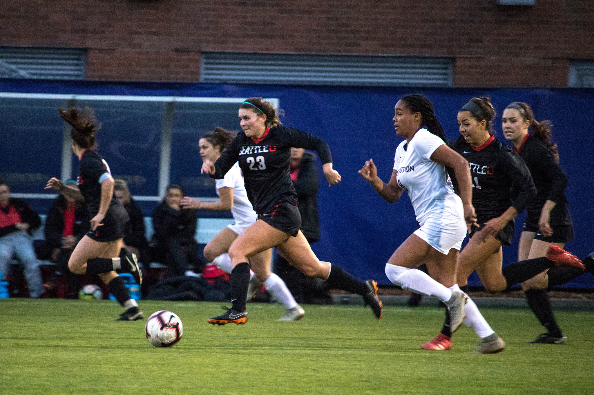 Junior Midfielder, Holly Rothering, dribbles past UW player as she charges to the goal.