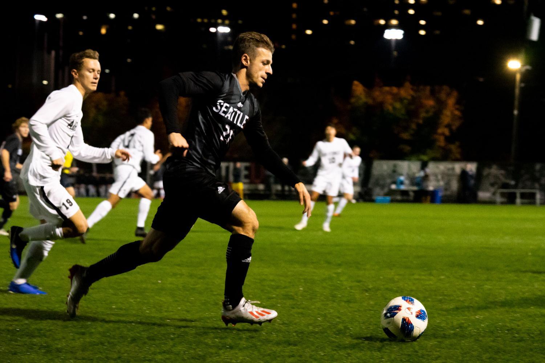 Thomas Mickoski, #21, dribbles the ball towards Airforce's net