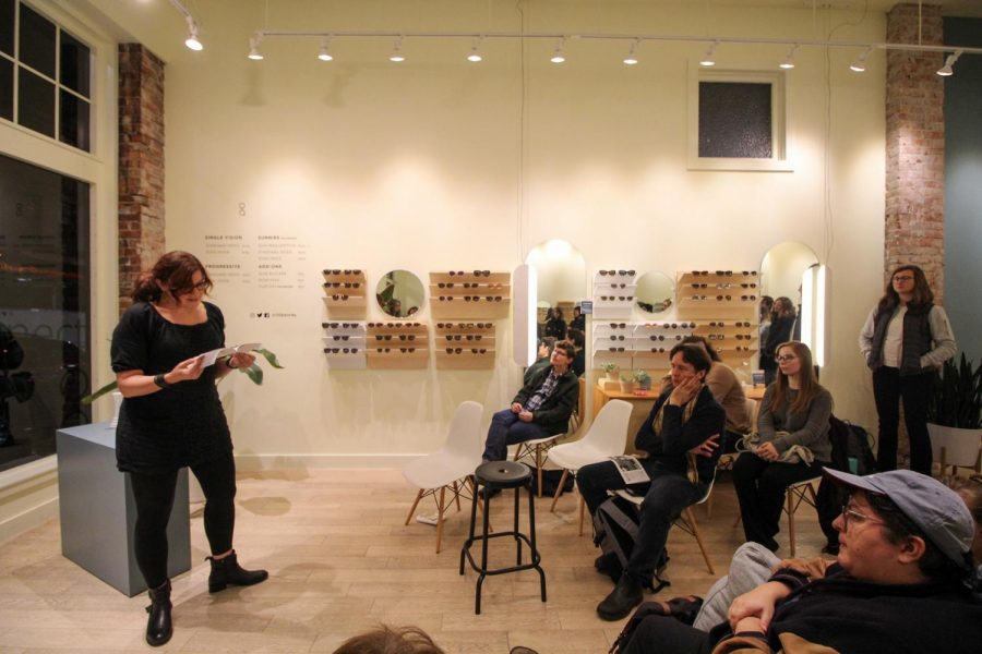 A+crowd+of+onlookers+listens+to+Jessica+Mooney+as+she+reads+from+her+book%2C+%E2%80%9CParting+Gifts+for+Losing+Contestants.%E2%80%9D