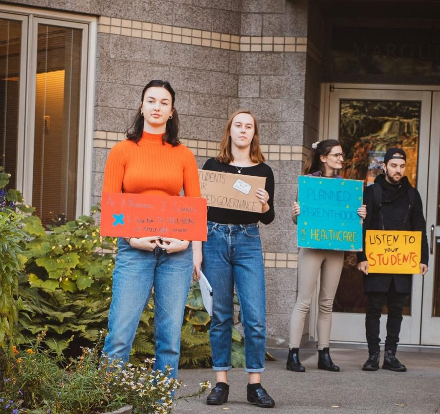 Students organized and participated in a silent protest in front of Seattle University's Casey Building on Monday, October 14th, 2019.