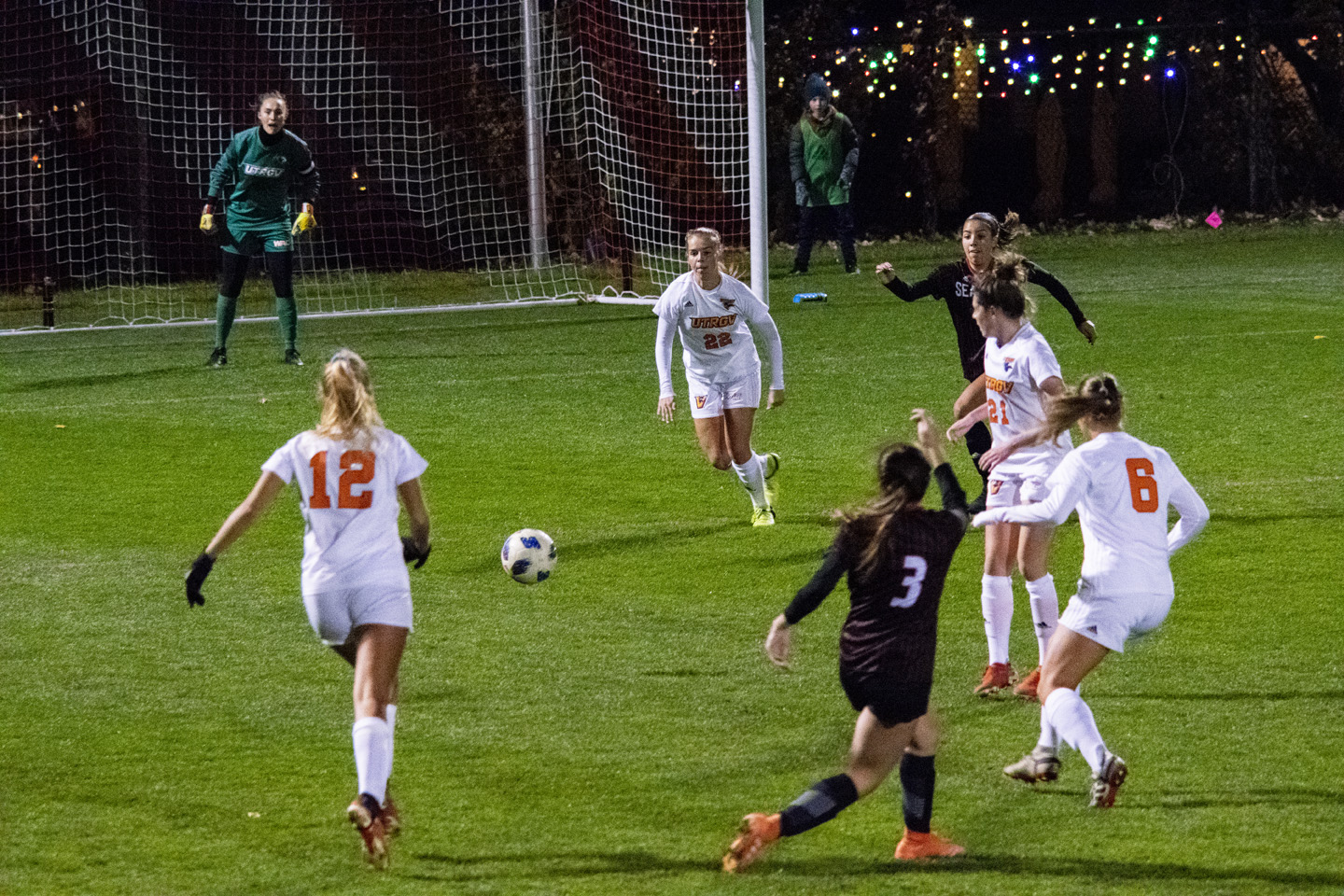 Gina Leete, #3, takes a shot at the goal under tight defense.