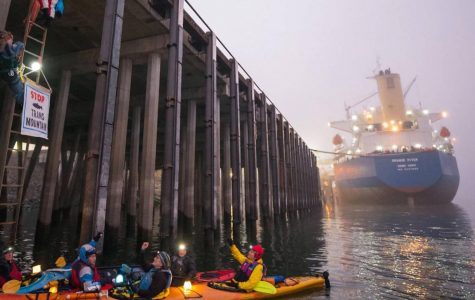 Protesters in a kayak blocking the Port of Vancouver