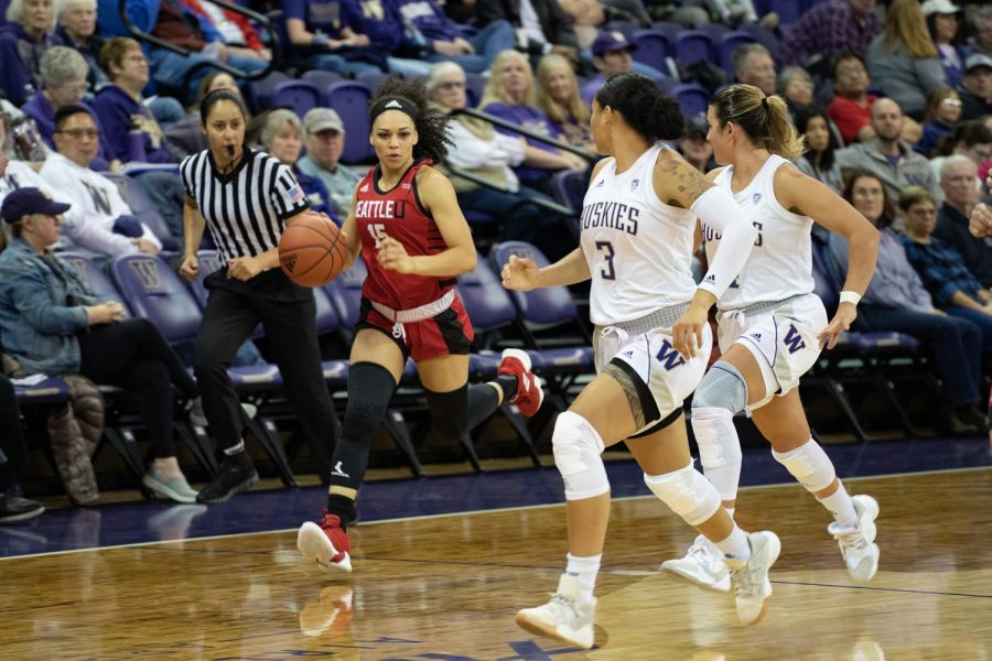 Kamira Sanders runs down the court in the fight against UW on November 23, 2019.