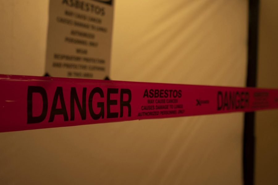 Signs+posted+outside+The+Cave+warned+students+of+asbestos+found+in+the+store.