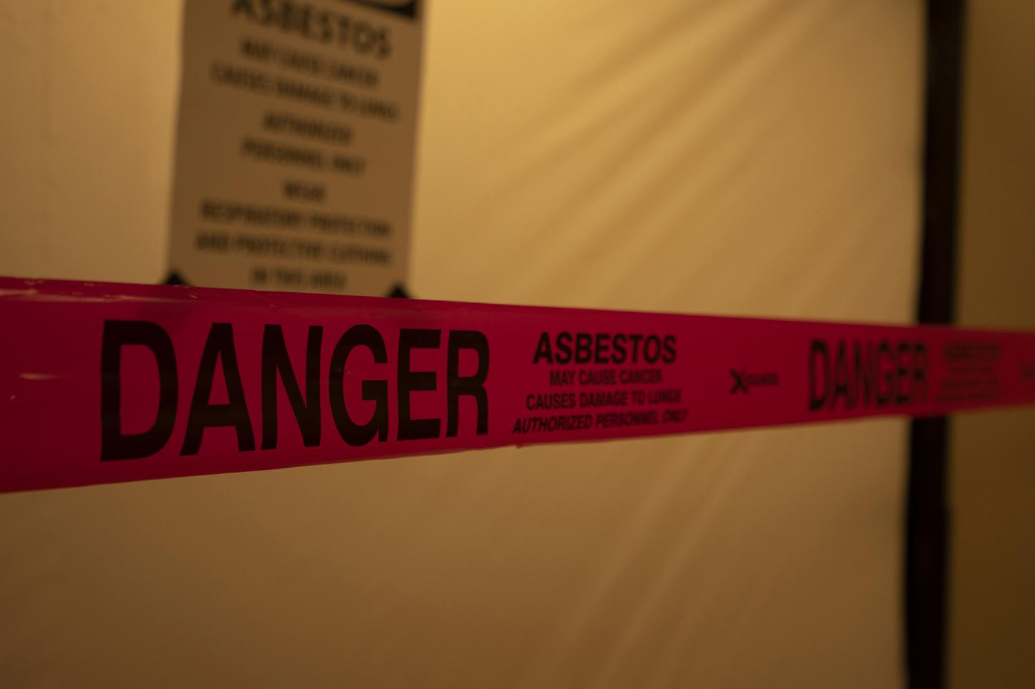 Signs posted outside The Cave warned students of asbestos found in the store.