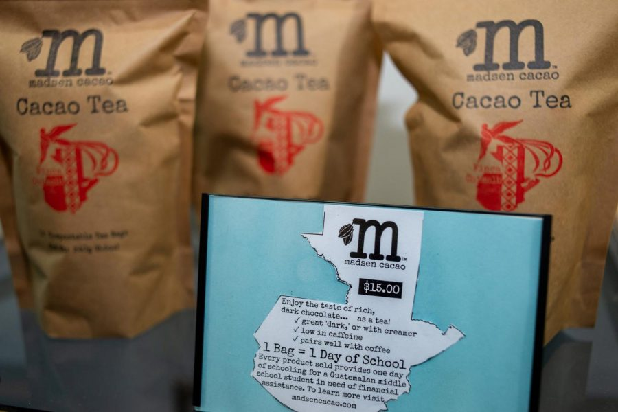 Good Neighbor Cafe sells ethically-sourced cacao tea packaged in eco-friendly compostable bags for customers to purchase, supporting children's education in Guatemala.