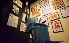 In the 'Body of Work' exhibit at the Museum of Pop Culture, a recreation of a tattoo parlor allows visitors to try on hologram designs.