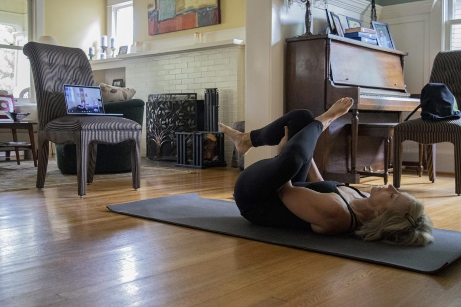 Randi Thoma, mother of a Seattle University student, participates in a Zoom yoga class from her dining room.