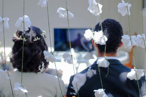 The newlyweds enjoy their Zoom wedding with their friends and family, all attending within their own homes.