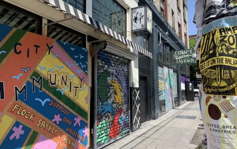 Capitol Hill restaurants Ikina and Comet Tavern boarded up due stay-at-home orders that prohibit dine-in.