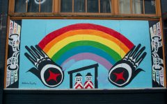 Mural painted by local artist Hailey Tayathy on plywood covering the windows outside of the Northwest Film Forum.
