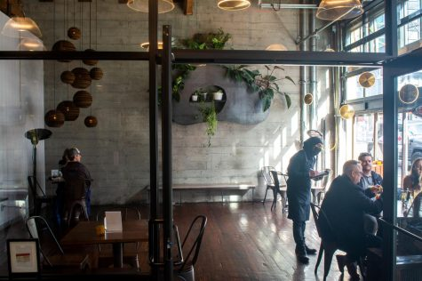 Plum Bistro, owned by Chef Makini Howell, was designed with urban and industrial touches made even more minimalistic by limited indoor dining.