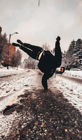 B-boy dancer showing off his moves while wearing protective mask outdoors!
