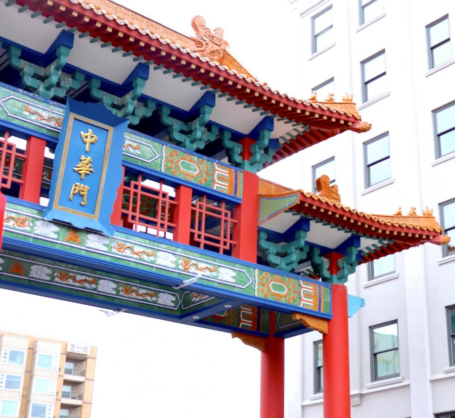 Intricate colorful archway contrasts the grays of the surrounding buildings and sky.