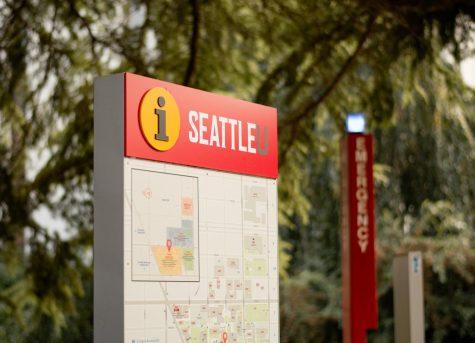 Seattle University information signage near emergency call box pillar.