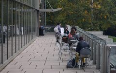 Students gather outside the library during lunch