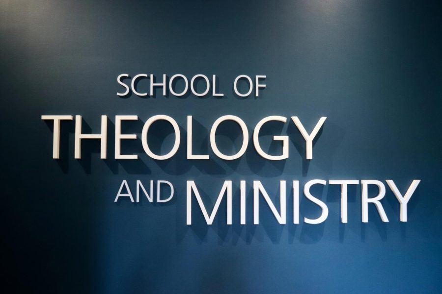 School of Theology and Ministry (STM) signage in the lobby of Hunthausen Hall.