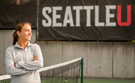 SU tennis player, Mireia Fehr, WAC Player of the Month, standing at outdoor campus tennis courts.